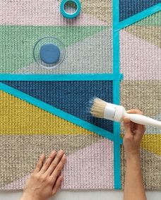 With this easy DIY rug project, see how painted triangles gives your plain rug a colorful, geometric upgrade. Painted Floor Cloths, Painted Rug, Weaving Loom Diy, Fluffy Rug, Cheap Rugs, Geometric Rug, Baby Knitting Patterns, Woven Rug, Small Rugs