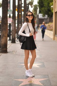 Somehow she can pull off converse heels! Love her outfit though.