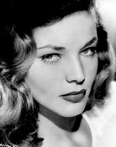 If only I could be this alluring, Ms Lauren Bacall (who did her own hair).