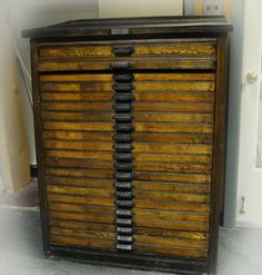 """Antique letterpress printers cabinet... wouldn't this make an awesome craft supply storage cabinet? Especially if you """"collect"""" beads like I do :-)"""