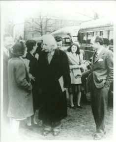 Albert Einstein on-campus in the late 1930s. Albert Einstein with Professor Homrighausen (far right) greeting refugees from Germany. Professor Homrighausen served with Einstein in a program, which brought groups of refugees from Nazi Germany to Princeton to meet Einstein and be welcomed and reassured in their transition to the U.S.