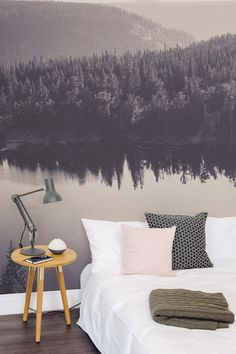 Drift away looking at this dreamy mountain landscape with this beautiful wallpaper mural. A slight pinkish hue makes this the perfect design for bedroom interiors looking for a subtle feminine touch.