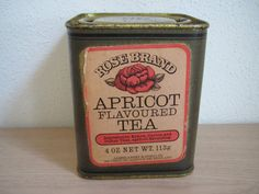 Rose Brand Apricot Flavoured Tea tin, blended and packed by James Ashby & Sons Limited, London, paper label on gold coloured square tin, c. 1980s?, UK