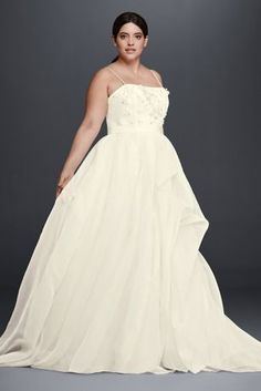 This lightweight organza wedding dress takes a flirty approach to the figure-flattering A-line silhouette. The beautiful bodice is designed with a sweetheart neckline, spaghetti straps, and fun 3D floral appliques.  Cheers Cynthia Rowley, exclusively at David's Bridal  Sweep