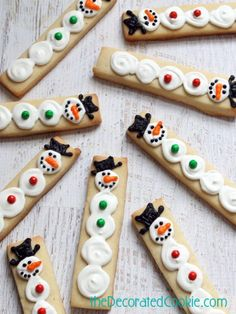 Snowmen Cookie Sticks - The Decorated Cookie || 21 Christmas Cookies Kids Can Bake!