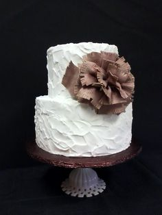I made this cake for a group of people celebrating their birthdays in the winter. All textured buttercream and I used a piece of burlap to put texture on the bow. Dark chocolate cake with bavarian cream and fresh raspberry filling. Except for the bow, this was the easiest cake I've done in a long time.
