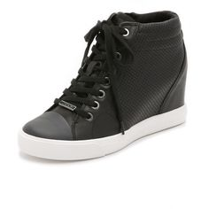 DKNY Cindy Wedge Sneakers ($125) ❤ liked on Polyvore featuring shoes, sneakers, black, black leather shoes, wedge sneakers, hidden wedge heel sneakers, perforated sneakers and black trainers