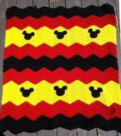 """Crocheted chevron baby blanket with your choice of Minnie Mouse or Mickey Mouse. Made with soft acrylic yarn in a smoke free, pet free home. Blankets measure approx. 25"""" x 30"""". Other colors and characters available. I gladly accept custom orders!"""