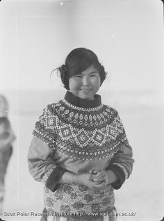Portrait of Gertrud, an Inuit, wearing a beaded collar covering her shoulders and chest.1930