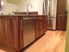 Sink/dishwasher in island. Designed by Kitchen Planners in Rockville, MD