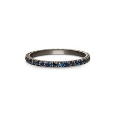 Mixed color eternity band featuring blue sapphires, navy sapphires and  black diamonds.  10% of all proceeds to go Oceana, a non-profit dedicated to exploring and  preserving the world's oceans.       * Black rhodium plated 14k white gold.      * Ring is approximately 1.7mm wide and takes 1.5