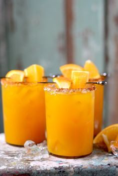 Orange Turmeric Margaritas are a sweet and smoky take on the classic cocktail. Homemade simple syrup. fresh juice and a salty, spiced rim make these drinks extra special but are still easy to make.