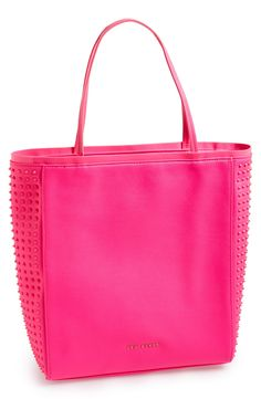 A studded hot pink piece of art. Can't get enough of this Ted Baker tote.