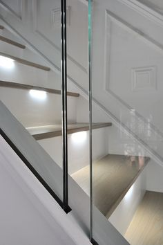 An ultra-modern staircase in light oak with LED lights installed under the treads to subtly illuminate the staircase. Staircase Outdoor, Winding Staircase, New Staircase, Staircase Design, Staircase Spindles, Concrete Staircase, Oak Stairs, Staircase Contemporary, Traditional Staircase