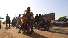 60 Seconds on Earth: Fighting ebola with a megaphone and a motorbike