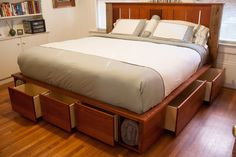 9 Space-Making Wood Storage Beds: A King-Sized Captains Bed. I would love to have a captain's bed like this. It was handcrafted from reclaimed wood! Bed Frame, Diy Storage Bed, Bed, Furniture, Platform Bed With Storage, Murphy Bed Plans, Best Storage Beds, Captains Bed, Murphy Bed Diy