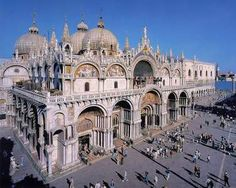 The Basilica Di San Marco, Venice's most famous church, was built in 830 to house the body of St. Mark. The adjacent Piazza di San Marco (St. Mark's Plaza) is the largest square in Venice and a great place to sit at one of the many outside cafes and relax, enjoy an overpriced drink or desert, and watch the people.