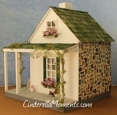 Debbie's Farmhouse dollhouse is ready. It's a wrap around porch farm. The front wall has hand carved brick I made from concrete patch. ...