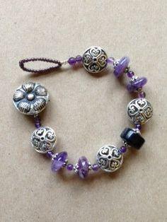 Purple flower bracelet by DebbiBoyneDesigns on Etsy, $23.00