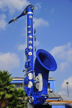 "This huge blue saxophone advertises the club, ""The Horn"" on Richmond Ave. Houston"
