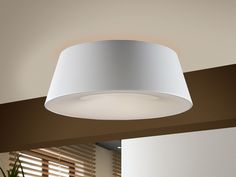 Ceiling lamp made of lacquered steel. Shade of anodized aluminum in matt off-white finish. Molded acrylic diffuser.