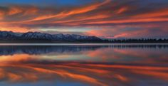 Red Down Under - i wasnt optimistic about the sunrise so I drove out of mt cook to twizel... and then bang... all over the southern alps. was great though and live to shoot another day!  more tours here: www.-iceland-photo-tours.com