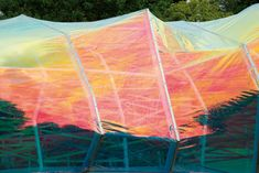 Iridescent, foil-like ETFE shines and shimmers on one section of the pavilion. Photo Credit: Johnny Tucker.