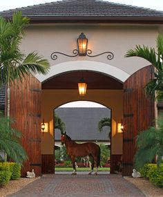 What a beautiful barn entrance at Two Swans Ranch, Wellington, Florida! #charleighscookies #dreambarns #equestrian