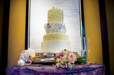 Intricate Piping and Floral Design add a modern look to this traditional 4-tiered wedding cake: Strawberry Shortcake with Whipped Cream Filling, Chocolate Cake with Chocolate Ganache and Coconut Cream Cake with Cream Cheese Filling.