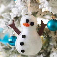 Felt Snowman Ornament - Deck the halls (or your Christmas tree) with our pint-size take on Frosty the Snowman. He's made of felt, ribbon, and some polyester fiberfill stuffing for a jolly low-cost gift.