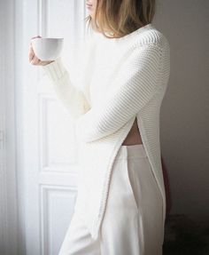 White woolen blouse with white pants. Beautiful design and combination.