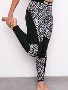 """Long stretch tribal printed leggings with an elastic waistband. Model is wearing a size Small. 36 ½"""" Length, 26"""" Waist, 28"""" Inseam 87% Polyester, 13% Spandex"""