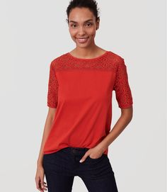 With a pretty lace yoke and sleeves, this cotton tee is where femme polish and casual cool meet. Round neck. Sheer lace yoke and short sleeves. Back button keyhole.