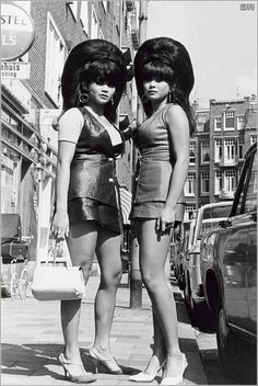 Thai twins with big beehives in Amsterdam in the 60's.