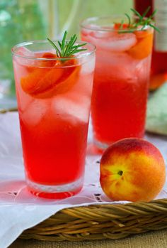 rosemary peach spritzer-3/4 cup sugar * 1 1/2 cups water * 4 large ripe peaches (about 1 3/4 pounds), halved, pitted, and cut into 1-inch slices * 4 sprigs rosemary, plus more for garnish * Ice, for serving * 4 cups cold white or rose wine * 1 liter cold club soda