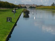 The Long Water Canal, Hampton Court. After Charles II became king, in 1660, he employed John Rose to make a canal, inspired by Versailles and 1.6 km long. It runs at 90° to the the axis of the Privy Garden.