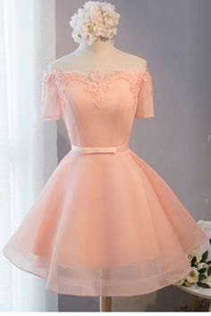 Peach and lace short prom style dress.