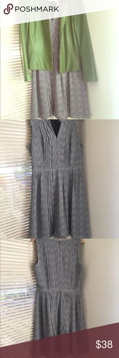 Halogen Dress Cute wear to work black and white dress with pleating panels down front and back.  Vneck front, has attached lining.  Professional and cute!  Worn very few times. Halogen Dresses
