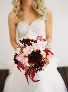 Now that Labor Day has come and gone, we have Autumn on our minds. Here are 10 gorgeous fall floral arrangements guaranteed to inspire those September-November brides.  	1.  	  	Photo by Stewart Leishman  	This bouquet wows us with a contrast of soft pink roses and calla lilies against deep red dahlias and amaranthus, with golden coxcomb and hypericum berries mixed in for texture.  	2.   	  	Photo by Lisa Lefkowitz  	Feminine meets rustic with this unique blend of trad...