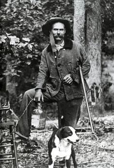 Daniel Duesst (pronounced due east) with his gun his dog and his jug of moonshine Sequatchie County Tennessee ca. 1900
