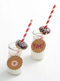 How to Celebrate Donut Day on June 5th: Since donuts were mean to be dunked, we're serving our Homemade Mini Chocolate-Covered Strawberry Donuts in adorable mini milk jugs with paper straws and scalloped paper tags decorated with mini donuts and festive phrases or stickers.