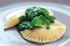 Homemade ravioli filled with ricotta, arugula and lime