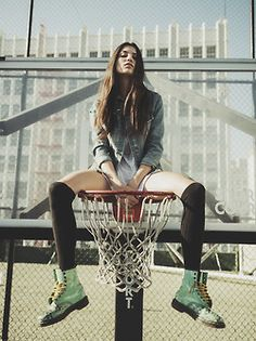 model on basketball field over the net ! Nice photoshoot
