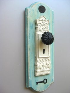use some sort of (less frilly) vintage door knob for hand towel holder in bathroom?