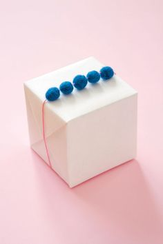 """Felted Ball Garland from """"Pretty Packages"""" by Sally J Shim / DIY on Oh Happy Day"""