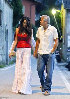 Cute couple: Unable to keep their hands off each other, the pair also were seen cosying up to one another other as they explored the sights of the city on their stroll to the restaurant