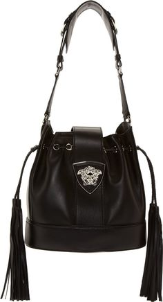 Versace Black Leather Bucket Bag 42404F070002  Buffed leather bucket bag in black. Silver-tone hardware. Single shoulder strap with pin-buckle hardware. Foldover tab at main compartment with signature Medusa accent and magnetic press-stud closure.
