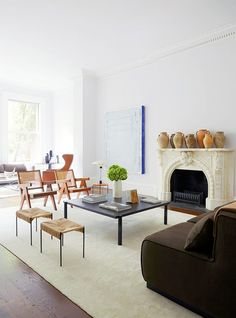 a modern white living room with a curated feel