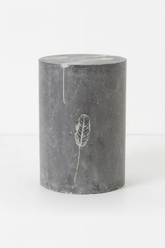 Cement stool with a pressed feather mold