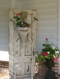 Spring Decorating Ideas - a vintage basket, filled with flowers and vintage garden tools - via  Mammabellarte